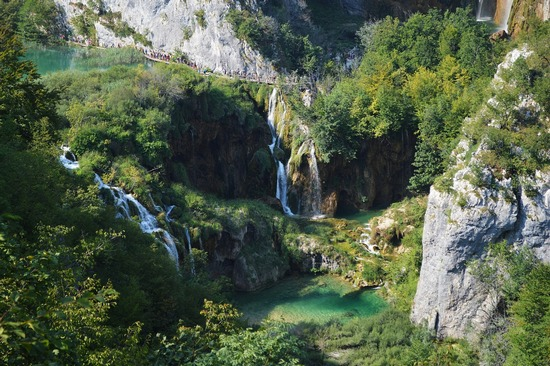 Plitvice Lakes National Park, with visitors high above it.