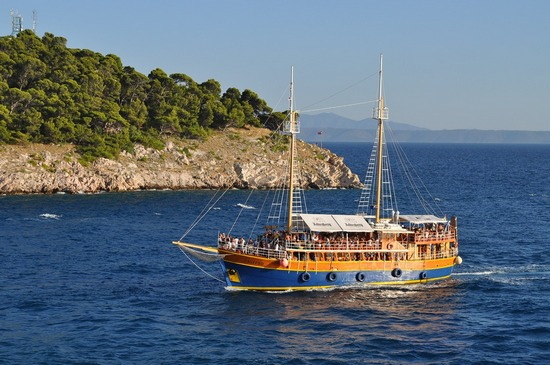 A cruising boat packed with tourists, near an island in Croatia